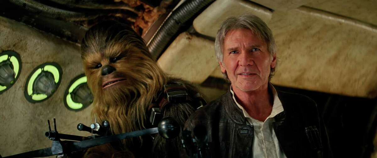 Star Wars: The Force Awakens L to R: Chewbacca (Peter Mayhew) and Han Solo (Harrison Ford).