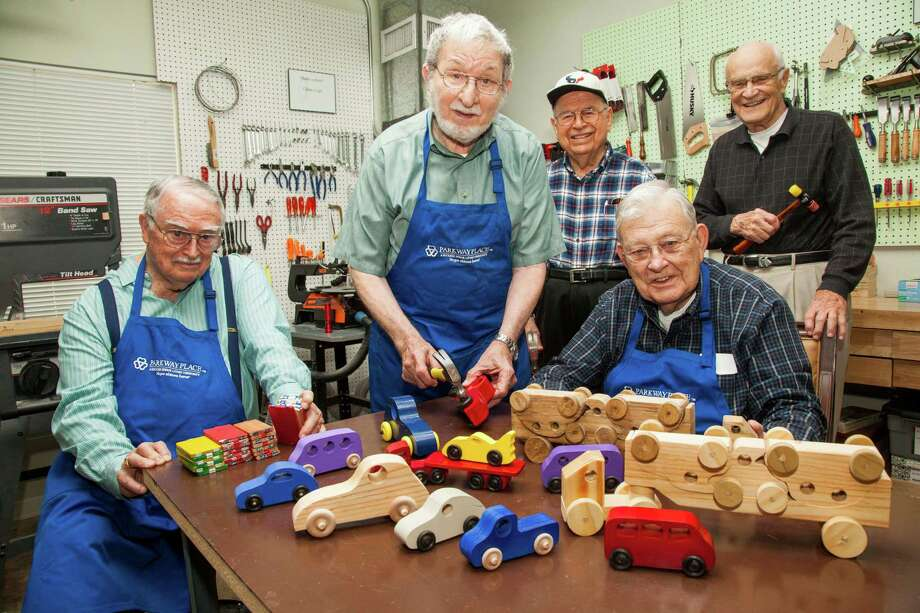 At the Parkway Place woodshop, residents Paul Smith, Joe Stassi, Aaron Mendoza Jr., Lynn Kinnamon and Richard Ferley build toys and ornaments for children around the world, and as gifts for family, neighbors and staff. Photo: Photo By Greg Schultheis