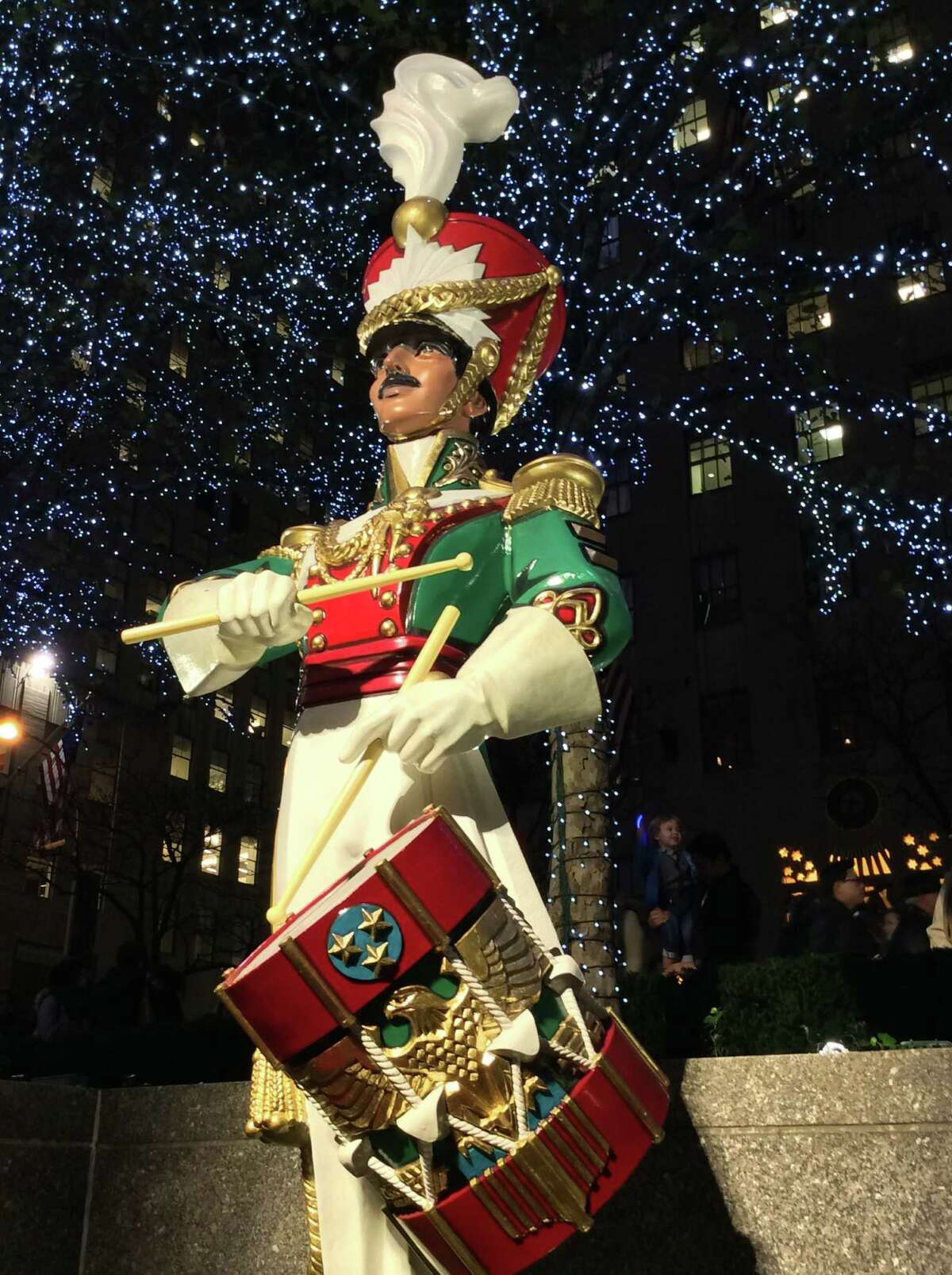 A drummer boy is spotted near the Rockefeller Center ice rink.