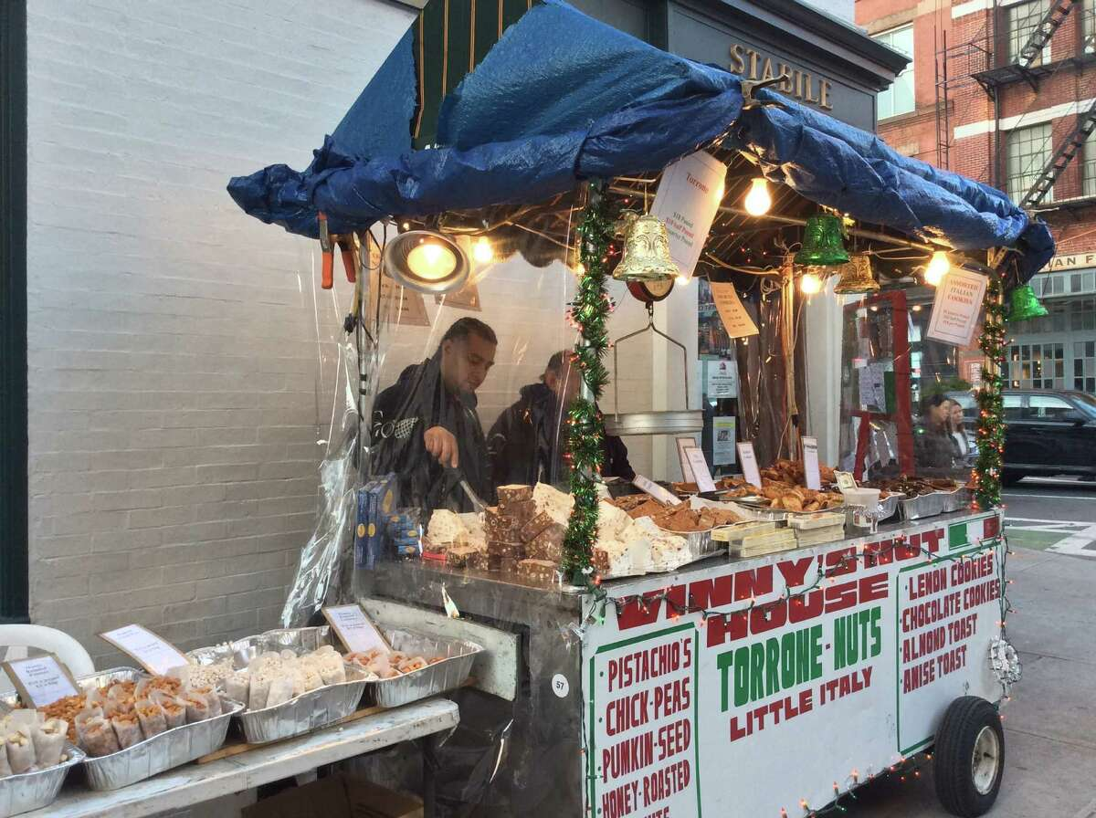 Vinny's Nut House in Little Italy sells a variety of specialty items on the street.