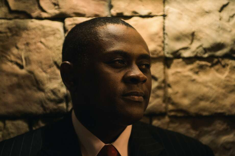 "Sacramento forensic neuropathologist Dr. Bennet Omalu, who is played by Will Smith in the new movie ""Concussion"" (opening Dec. 25). While working in Pittsburgh in 2002, Dr. Omalu discovered CTE (chronic traumatic encephalopathy), a debilitating brain trauma brought on by repeated blows to the head, while conducting an autopsy on deceased Steelers Hall of Fame player Mike Webster. Omalu, a Nigerian immigrant, published his findings and was soon met with the NFL's attempts to discredit his research. Now a professor of medicine at UC Davis and coroner for San Joaquin County, Omalu has remained an outspoken advocate to raise awareness of the dangers associated with repeated football-related head trauma. We speak with him about the film and his research and ongoing advocacy. Photo: MICAH ALBERT \ Special To The Sa"