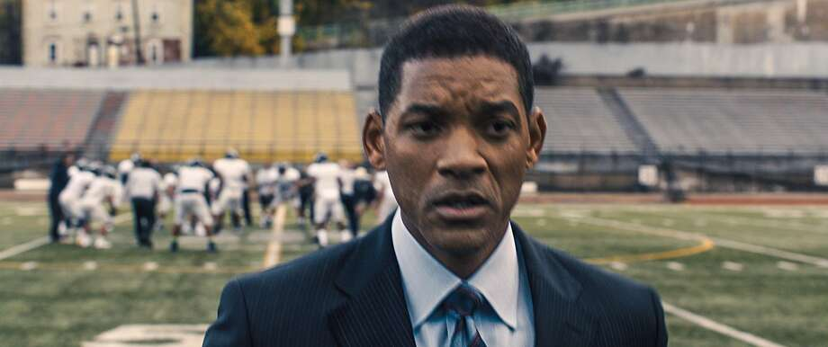 "Will Smith plays the Nigerian-born Dr. Bennet Omalu, right, in the film ""Concussion."" Photo: Associated Press"
