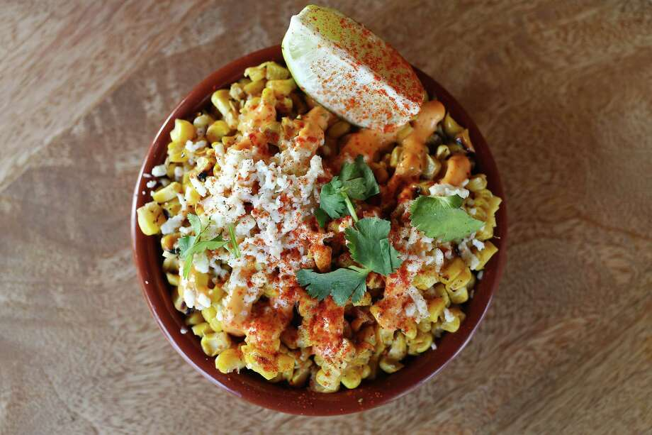 A favorite snack at festivals throughout Mexico, esquites features roasted corn with queso fresco minced cilantro and a topping of powdered chile. Photo: JERRY LARA /San Antonio Express-News / © 2015 San Antonio Express-News