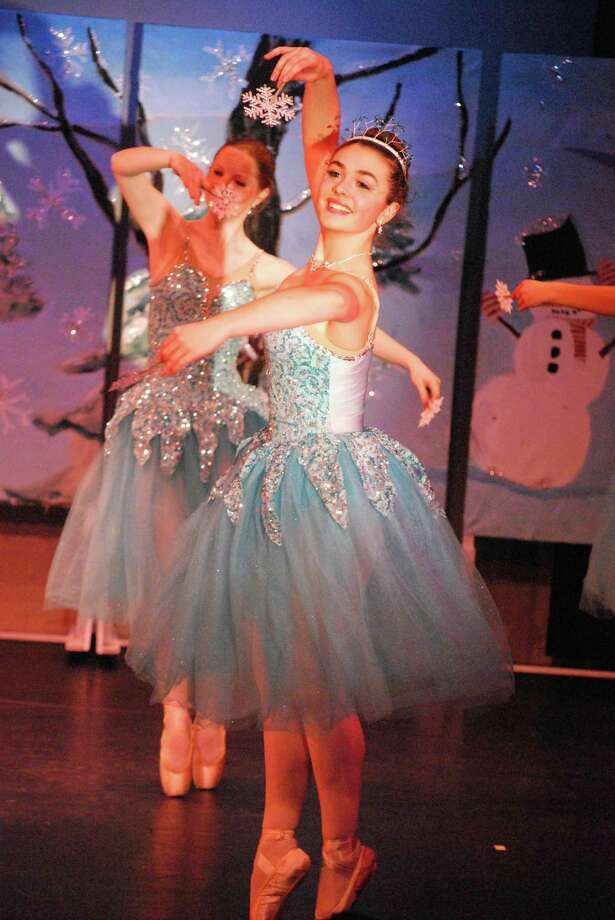 """""""Scenes from the Nutcracker,"""" performed by the Darien Art Center's dance companies and geared for younger audiences, will take place at the DAC Weatherstone Studio at 2 Renshaw Road, behind the Darien Town Hall. Performances are Dec. 18 at 6 p.m., Dec. 19 at 11 a.m., 2 p.m., and 5 p.m. and Dec. 20 at noon and 3 p.m. Reservations are recommended. Call the DAC box office at 203-655-8683 or email Bonnie@darienarts.org for reservations. Pictured are Ashley Cassetta, front, and Hannah Ferguson, rear, in last year's performance. Photo: Contributed / Contributed Photo / Darien News"""
