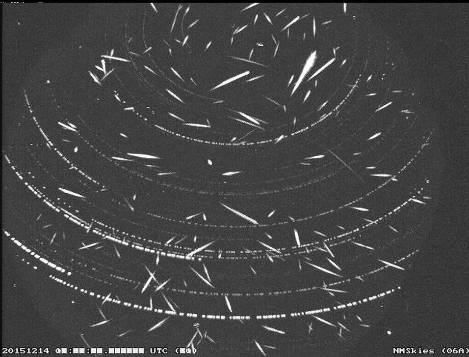 This composite image shows meteors observed in the skies over Mayhill, N.M., during the Geminid Meteor Shower on Dec 13-14, 2015. More than 200 individual meteor images observed throughout the night were combined to create this composite. The linear streaks are meteors, most of them Geminids, and the dotted arcs are stars and planets.The Geminids are typically visible Dec. 4-17. Photo: Christian, Carol, NASA Marshall Space Flight Center