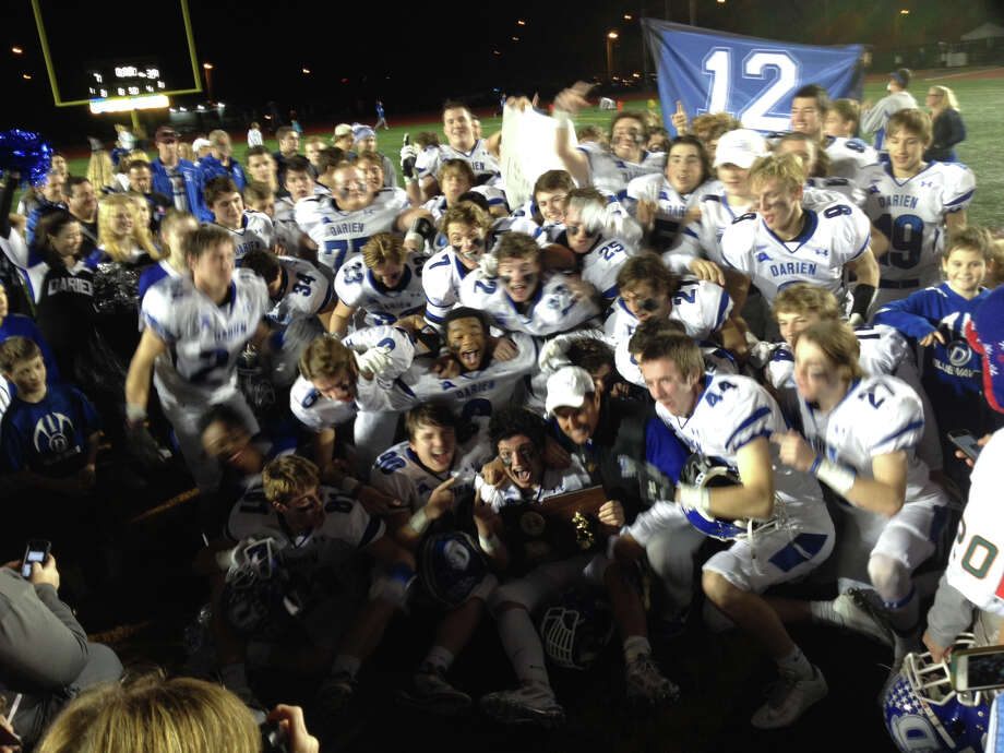 The Darien football team celebrates its 39-7 win over Shelton in the CIAC Class LL football championship on Saturday, Dec. 12, 2015 in New Britain. Photo: Matthew Brown / For Hearst Conne / Matthew Brown / For Hearst Conne / Stamford Advocate Freelance
