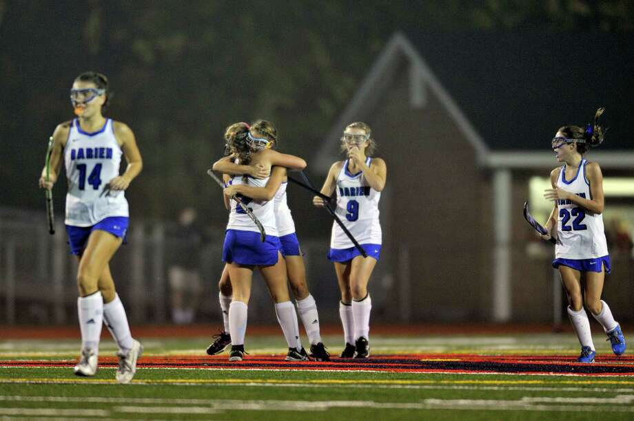Darien goalscoerer Georgia Cassidy, 2, gets hugged after putting her team ahead of Wilton in the FCIAC girls field hockey championships held at Brien McMahon High School in Norwalk on Nov. 5, 2015. Photo: Michael Cummo / Hearst Connecticut Media / Stamford Advocate