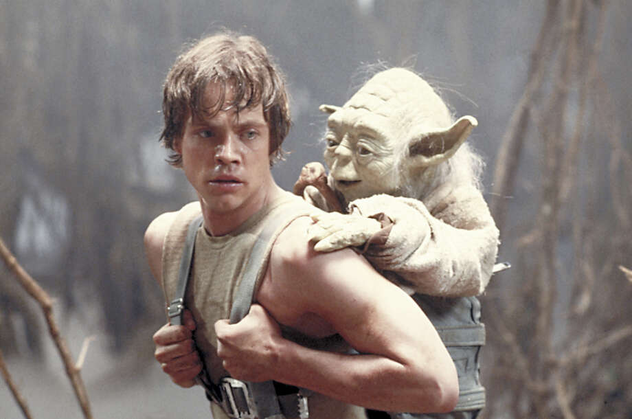 "FILE - This 1980 publicity image originally released by Lucasfilm Ltd., Mark Hamill as Luke Skywalker and the character Yoda appear in this scene from ""Star Wars Episode V: The Empire Strikes Back."" The Library of Congress announced early Tuesday Dec. 28, 2010 that the film will be preserved by the Library of Congress as part of its National Film Registry.  (AP Photo/Lucasfilm Ltd) Photo: Anonymous / AP2004"