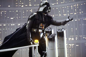 """Darth Vader is shown in a scene from Lucasfilm's """"Star Wars: Episode V, The Empire Strikes Back,"""" in this undated promotional photo. Lucasfilm Ltd. and 20th Century Fox announced Tuesday, Feb. 10, 2004, that the original three """"Star Wars"""" films will be released on DVD Sept. 21, 2004 in North America. (AP Photo/Lucasfilm, Ltd. & TM)"""