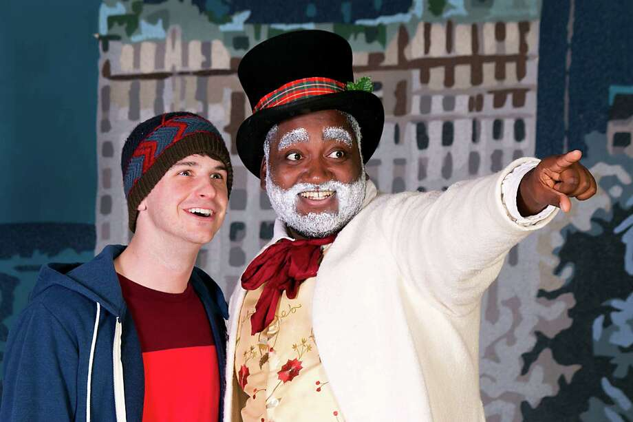 Terrance Jackson, wearing top hat, portrays a snowman, Frosty, who comes to life in the Barter Players' production for children and their families at the Quick Center in Fairfield on Saturday, Dec. 19. Photo: Contributed Photo