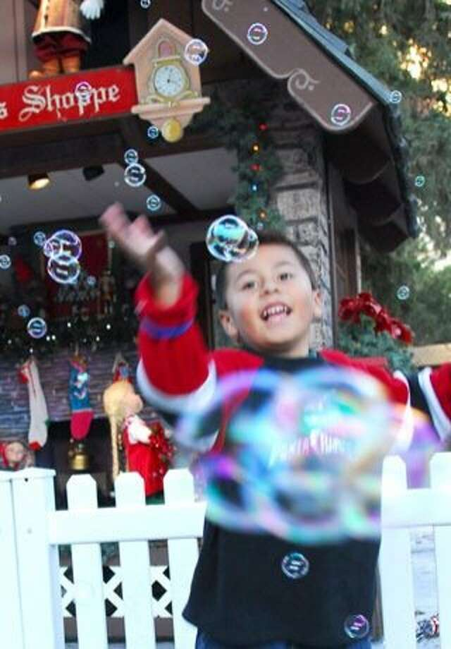 A boy chases bubbles at Christmas in the Park, a San Jose tradition. Photo: Christmas In The Park