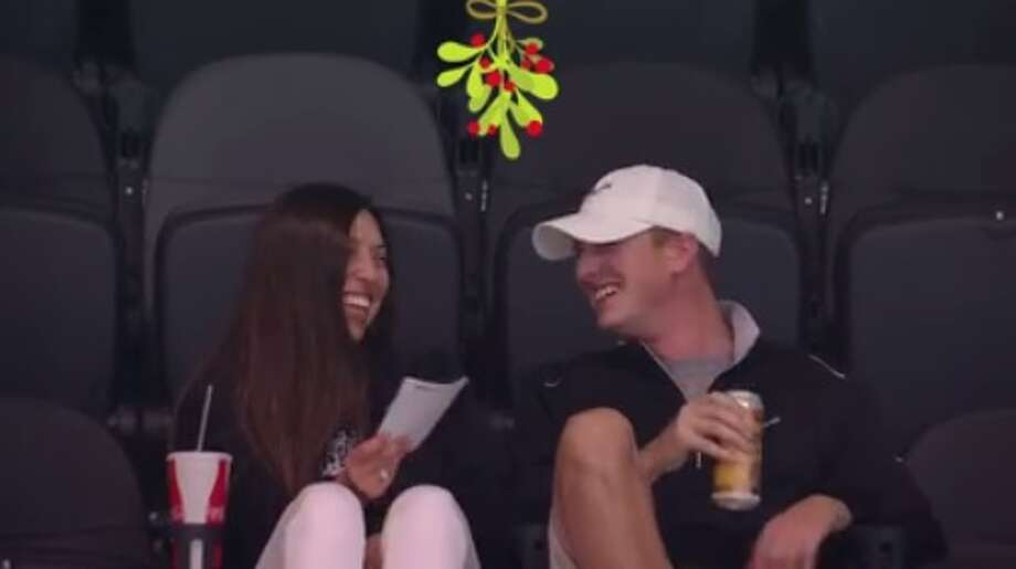 """Sometimes """"kiss me"""" cameras are cute and other times, like for one Spurs fan couple inside the AT&T Center, they just make things awkward."""