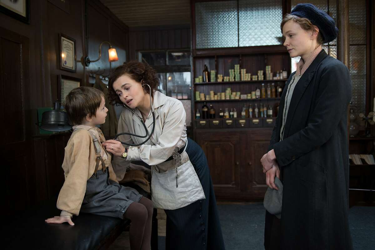 """In this image released by Focus Features, Adam Michael Dodd portrays George Watts, from left, Helena Bonham Carter portrays Edith Ellyn and Carey Mulligan portrays Maud Watts, in a scene from """"Suffragette."""" (Steffan Hill/Focus Features via AP)"""
