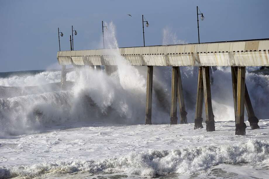Huge waves hit the Pacifica Pier with such force that the concrete footing shudders. The pier is closed during big storms. Photo: Marcio Jose Sanchez, Associated Press