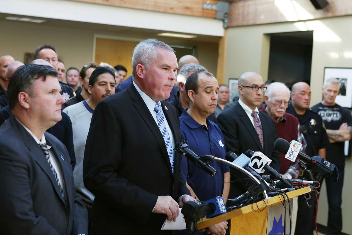 Martin Halloran (second from left), San Francisco Police Officers Association president, speaks during a press conference on Dec. 16, 2015, in San Francisco.
