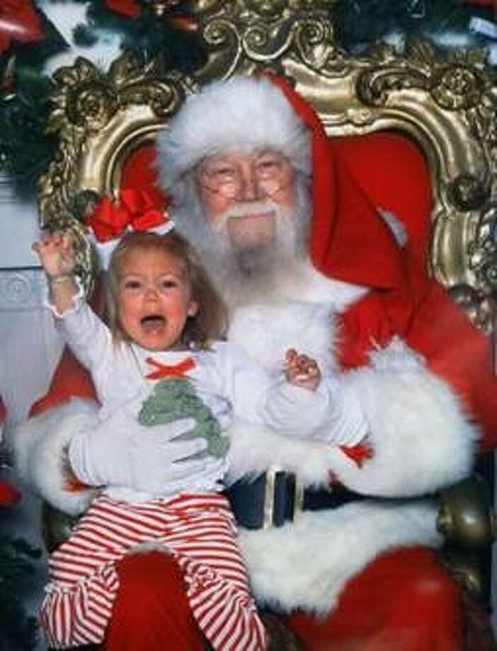 Vidor resident Lyndsi Goins submitted this photo of her daughter sitting on Santa's lap as part of Great American Cookies' #keepsantajolly contest. Goins received a $250 gift card after the company selected her photo as the weekly winner.