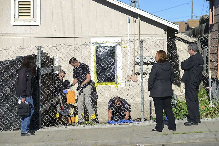 Code of Enforcement Officers observe an excavation conducted by Salinas Police Officers at Tami Joy Huntsman's backyard in Salinas, Calif., on Dec. 16, 2015. Huntsman, 39, and her 17-year-old boyfriend, Gonzalo Curiel, are under arrest  in connection with a case in which an abused, starved 9-year-old girl was found in East Quincy and, later, the bodies of two young children being found in a Redding storage unit. Photo: Brandon Chew, Special To The Chronicle