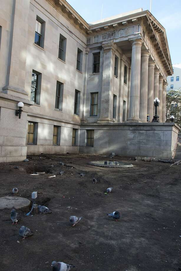 A tree, signage, trash and other debris have been removed from the grounds surrounding the Old Mint building in San Francisco Wednesday, December 16, 2015. Photo: Douglas Zimmerman