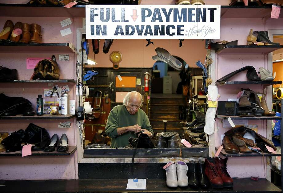 Carlos Lopez works on a shoe at Haight Street Shoe Repair in San Francisco, California, on Monday, Dec. 14, 2015. Photo: Connor Radnovich, The Chronicle