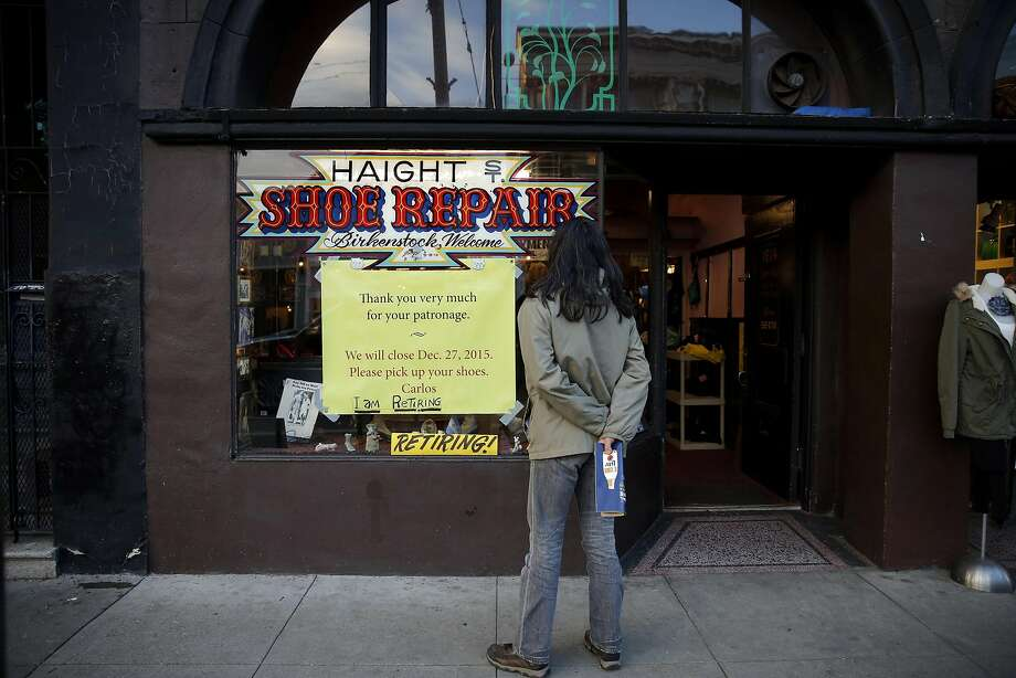A man reads a sign outside Haight Street Shoe Repair in San Francisco, California, announcing its closure, on Monday, Dec. 14, 2015. Photo: Connor Radnovich, The Chronicle