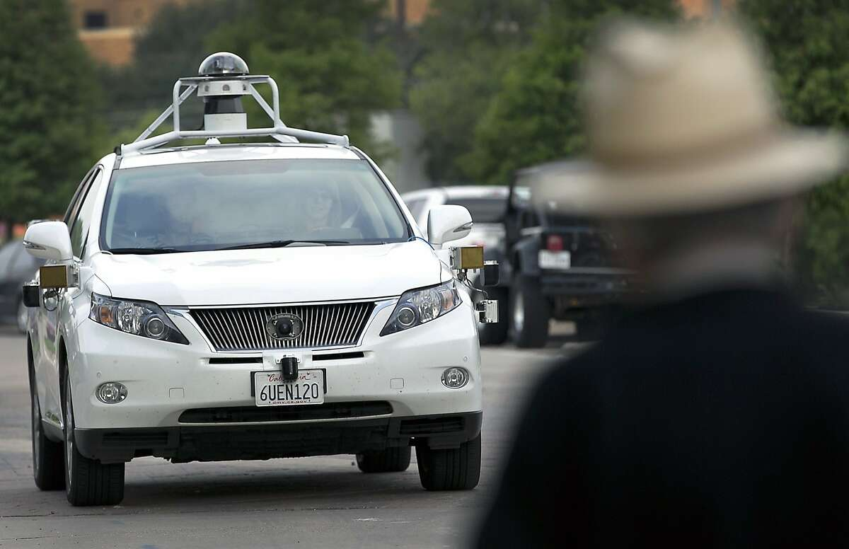 In this 2015 photo, a Google self-driving SUV is viewed in Austin, Texas. Hustling to bring cars that drive themselves to a road near you, Google finds itself somewhere that has frustrated many before: Waiting for help from California's department of motor vehicles. Over the summer, Google expanded its road testing from Silicon Valley to Texas, where state law would not prohibit cars without pedals and a wheel. (Ralph Barrera/Austin American-Statesman via AP) AUSTIN CHRONICLE OUT, COMMUNITY IMPACT OUT, INTERNET AND TV MUST CREDIT PHOTOGRAPHER AND STATESMAN.COM, MAGAZINES OUT; MANDATORY CREDIT