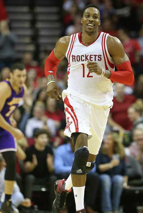 Rockets center Dwight Howard has been ordered to cease his use of a spray-on adhesive. Photo: Elizabeth Conley, Staff / © 2015 Houston Chronicle