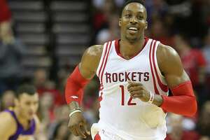 Houston Rockets center Dwight Howard (12) is all smiles after scoring in the second half of NBA game action against  LA Lakers at Toyota Center on Saturday, Dec. 12, 2015, in Houston. ( Elizabeth Conley / Houston Chronicle )
