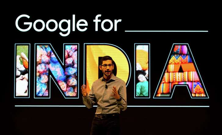 Google CEO Sundar Pichai speaks as he announces the company's plans for expanding products and services in India at a news conference in New Delhi, India, Wednesday, Dec. 16, 2015. Google says 6 million Indians are gaining Internet access every month, and expects there to be 500 million Indians online by 2017. (AP Photo/Saurabh Das)