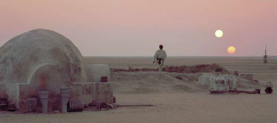 "Luke Skywalker leaves his home and watches the twin suns of Tatooine set in a scene from the film ""Star Wars."" The home seen in the foreground is the basis of a series of homes rapper Kanye West is hoping to build to help with California's housing crisis. Photo: LUCASFILM LTD. / © Lucasfilm Ltd. & TM. All Rights Reserved."