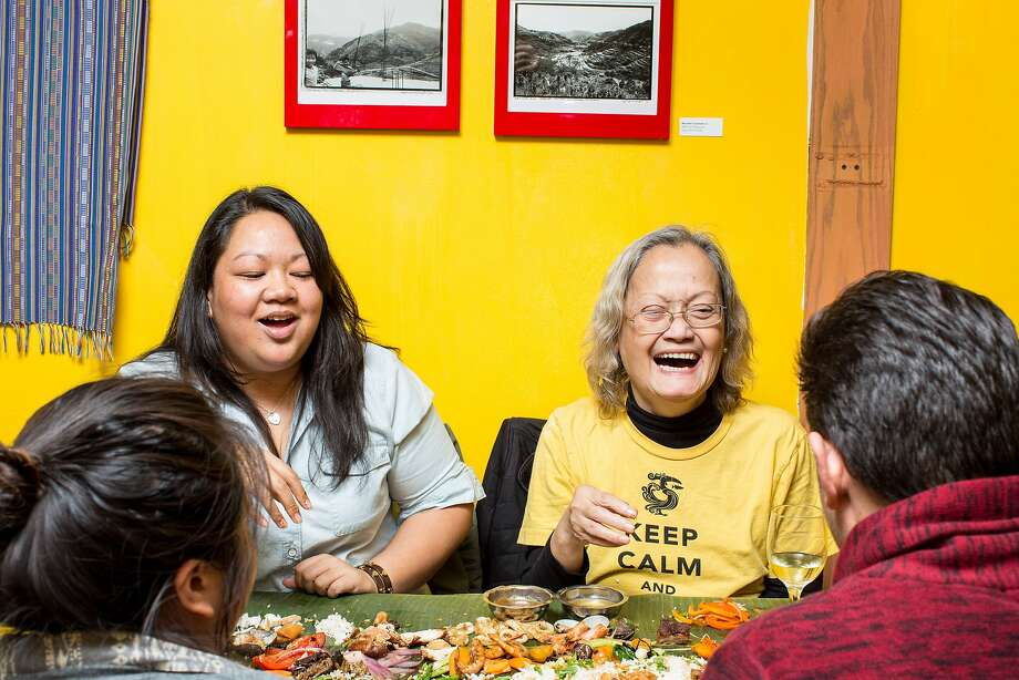Kim Boral, left, Joanne Boston, Pearl Parmelee aka Tita Pearl, and P. J. Quesada, who are on the board of directors of the Filipino Food Movement, dine on a Kamayan dinner at Pampalasa, on Friday, Dec. 4, 2015 in San Francisco, Calif. Photo: Aubrie Pick, Special To The Chronicle