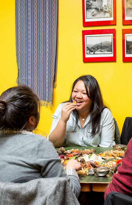 Kim Boral, left, and Joanne Boston, who are on the board of directors of the Filipino Food Movement, dine on a Kamayan dinner at Pampalasa, on Friday, Dec. 4, 2015 in San Francisco, Calif. Photo: Aubrie Pick, Special To The Chronicle