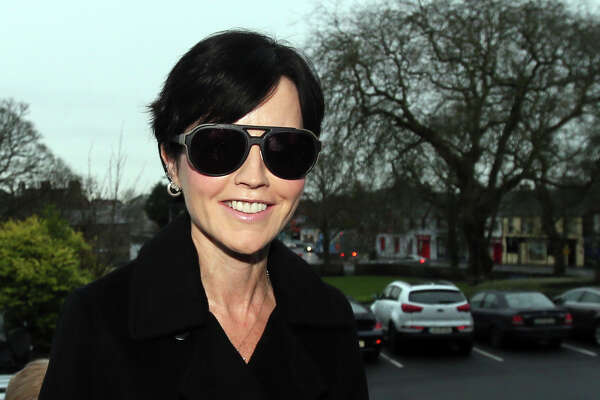 Cranberries singer Dolores O'Riordan arrives at Ennis District Court in Ennis, Ireland, Wednesday, Dec. 16, 2015. The lead singer of the Irish rock band The Cranberries, Dolores O'Riordan, has pleaded guilty to assaulting three policemen and a flight attendant during an alleged psychotic episode last year. Her lawyer said she accepted evidence of the assault and obstruction charges facing her. Judge Patrick Durcan ordered the singer to write letters of apology to those she attacked and that he would sentence her early next year. She faces possible penalties ranging from a cash fine to six months' imprisonment. (Niall Carson/PA via AP)     UNITED KINGDOM OUT      -     NO SALES      -      NO ARCHIVES ORG XMIT: LON804