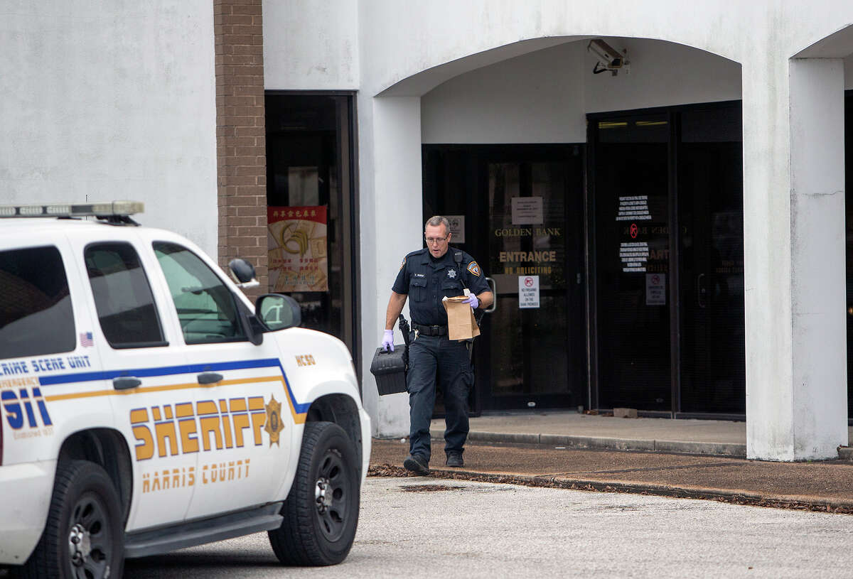 Authorities on Wednesday work the scene of a robbery at the Golden Bank at 6623 FM 1960 near Shiloh Church. Gunshots were fired during the robbery Wednesday morning in northwest Harris County. No other details about the incident, including descriptions of the robbers, were available.