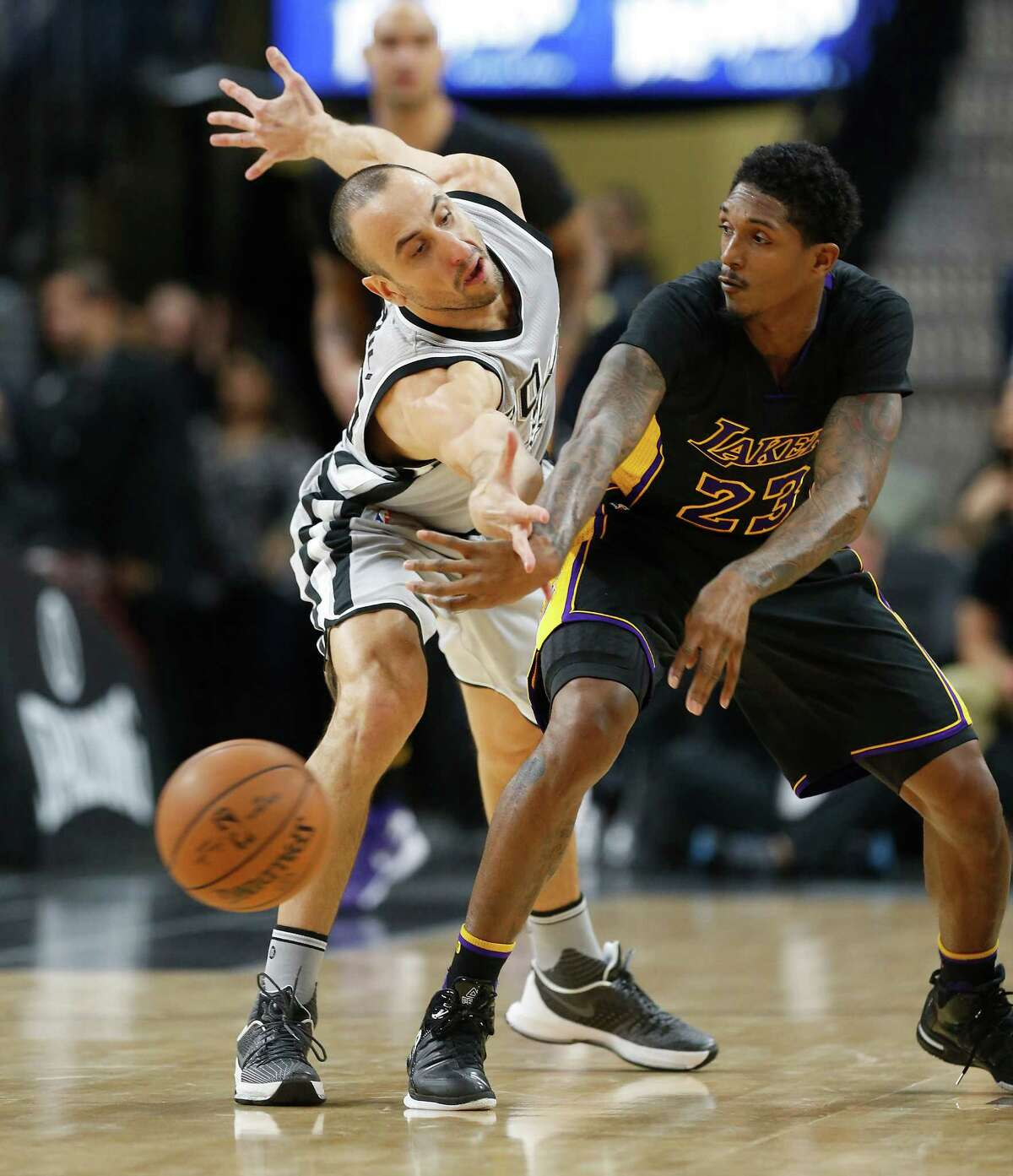 Spurs' Manu Ginobili (20) defends against Los Angeles Lakers' Louis Williams (23) at the AT&T Center on Friday, Dec. 11, 2015. (Kin Man Hui/San Antonio Express-News)