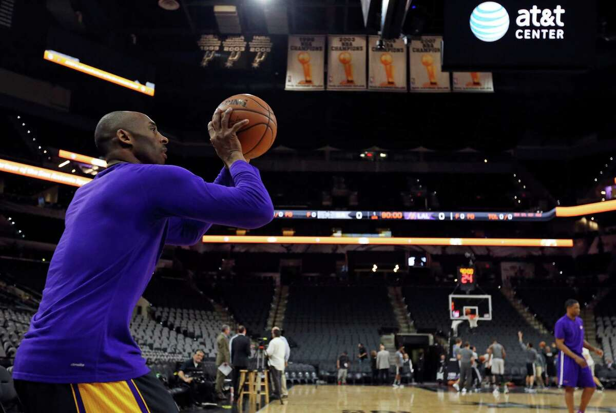 Los Angeles Lakers' Kobe Bryant shoots before the game with the San Antonio Spurs Friday Dec. 11, 2015 at the AT&T Center.