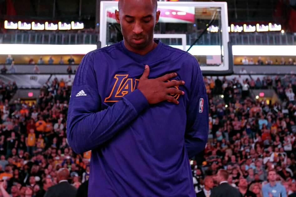 Los Angeles Lakers' Kobe Bryant stands during the national anthem before the game with the San Antonio Spurs Friday Dec. 11, 2015 at the AT&T Center.