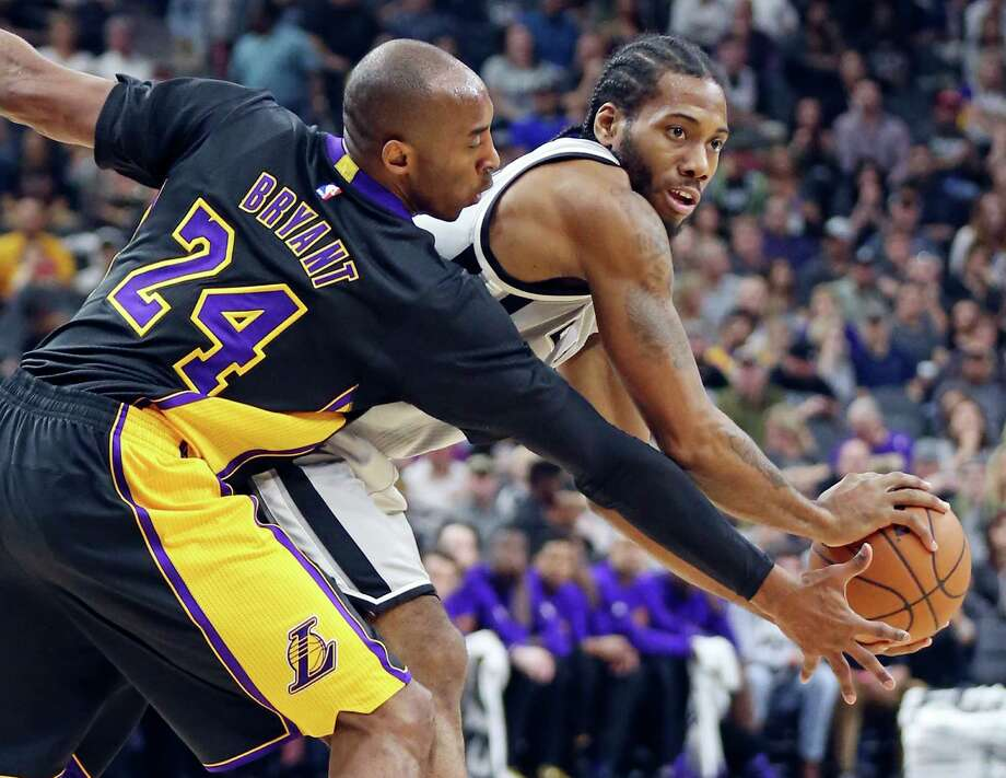 San Antonio Spurs' Kawhi Leonard looks for room around Los Angeles Lakers' Kobe Bryant during first half action Friday Dec. 11, 2015 at the AT&T Center. Photo: Edward A. Ornelas, Staff / San Antonio Express-News / © 2015 San Antonio Express-News