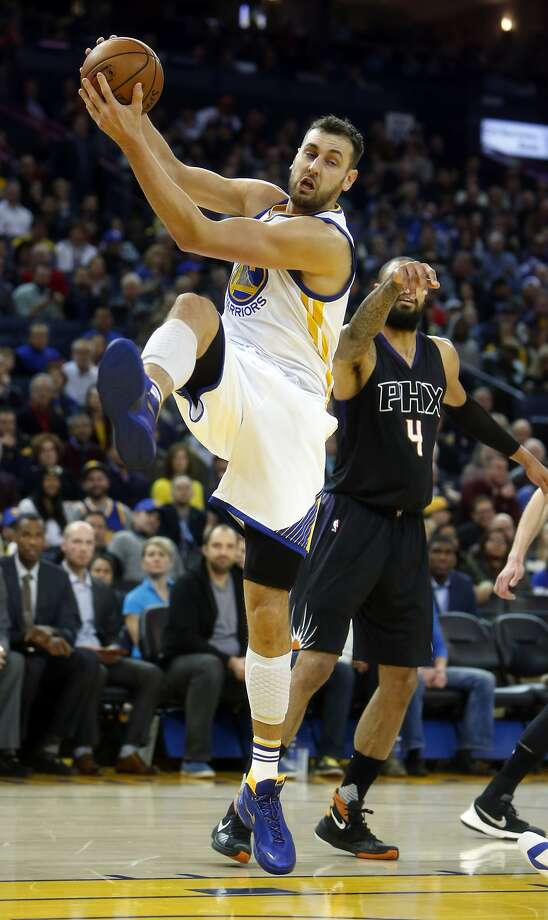 Golden State Warriors' Andrew Bogut grabs a rebound in 1st quarter against Phoenix Suns' Tyson Chandler in NBA game at Oracle Arena in Oakland, Calif., on Wednesday, December 16, 2015. Photo: Scott Strazzante, The Chronicle