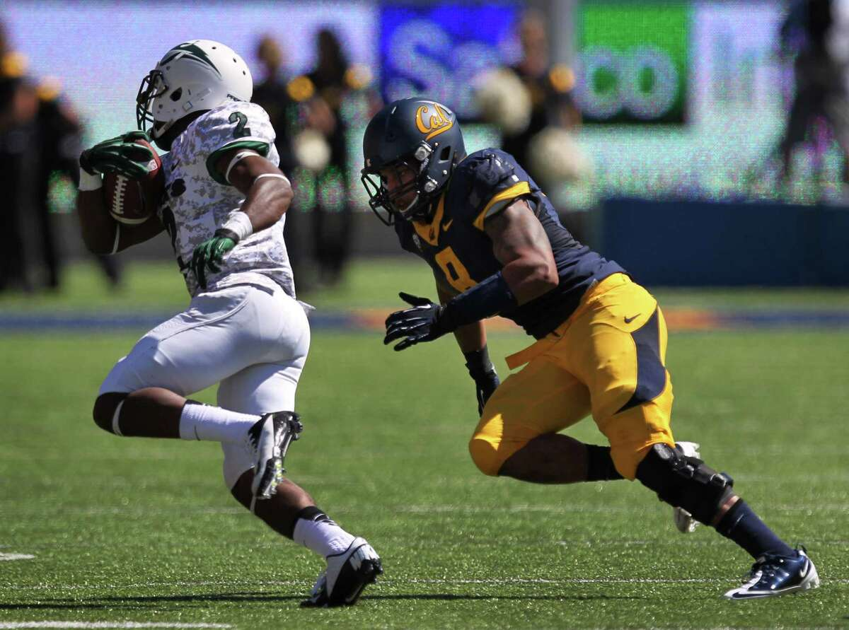 Cal's Michael Barton, right, prepares to tackle Portland's Shaquille Richard during the California vs. Portland State football game September 7, 2013 at Memorial Stadium in Berkeley, Calif.