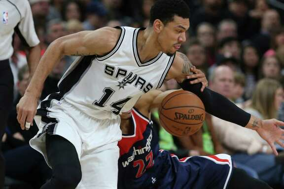 Spurs' Danny Green gets a loose ball against Washington Wizards' Otto Porter Jr. during the first half at the AT&T Center on Dec. 16, 2015.