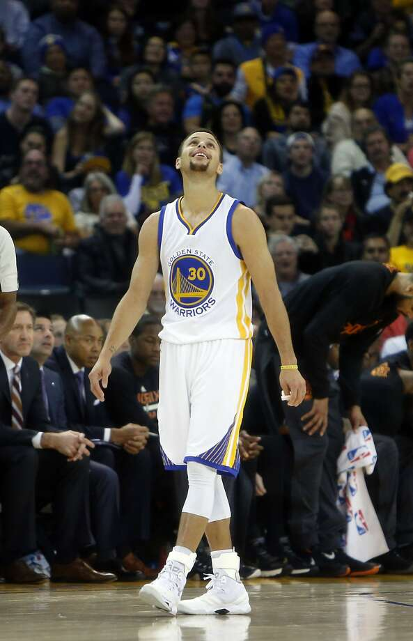 Golden State Warriors' Stephen Curry smiles after being called for a foul in 3rd quarter while playing Phoenix Suns in NBA game at Oracle Arena in Oakland, Calif., on Wednesday, December 16, 2015. Photo: Scott Strazzante, The Chronicle