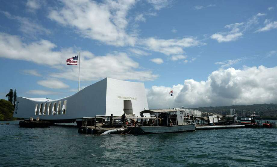 Now:A memorial of the U.S.S. Arizona stands in Pearl Harbor to honor some of the 1,177 sailors and Marines killed on the naval ship during the Japanese surprise attack on Pearl Harbor in 1941. Photo: Laurie Dexter, HOGP / US Navy