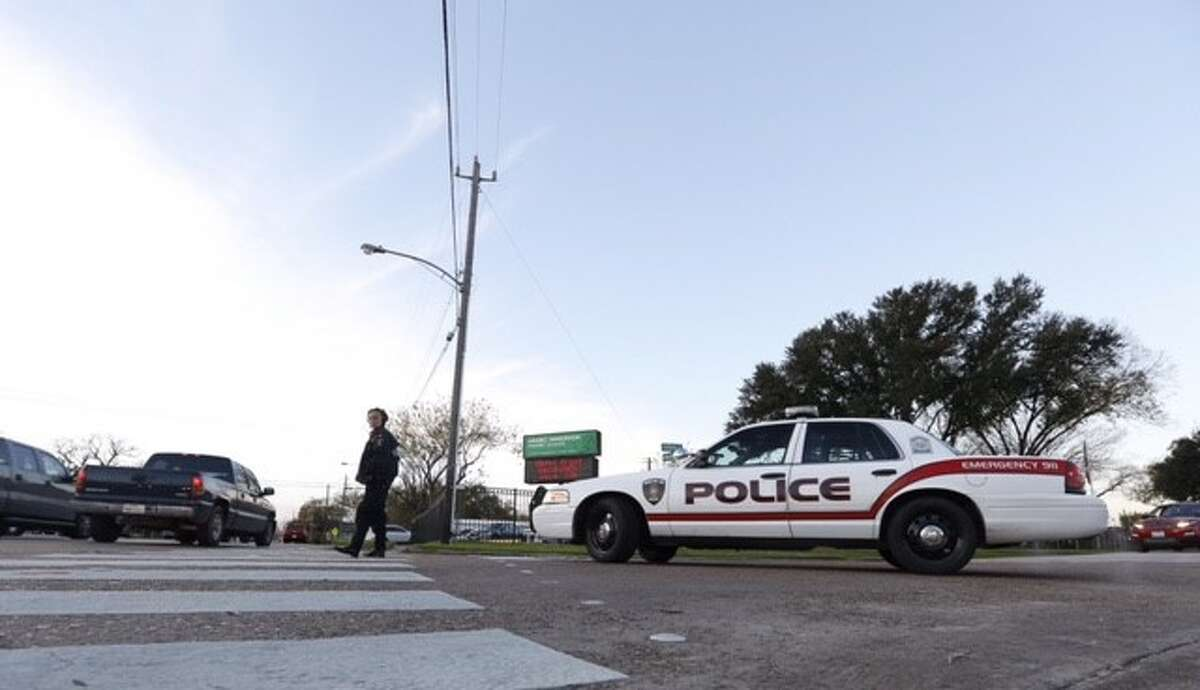 At the Arabic Immersion School in north Houston, a police car blocked one entrance, and an officer patrolled the sidewalk on the other side of the campus in the wake of terror threats across the country. Dec. 17, 2015