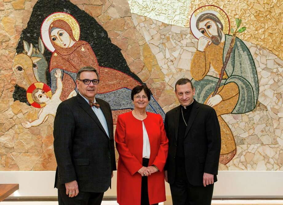 PHOTO CAPTION: From left are Sacred Heart University President John J. Petillo, Catholic Studies Chair Michelle Loris and Bishop Frank J. Caggiano in the Chapel of the Nativity at SHU on December 6, 2015. 
