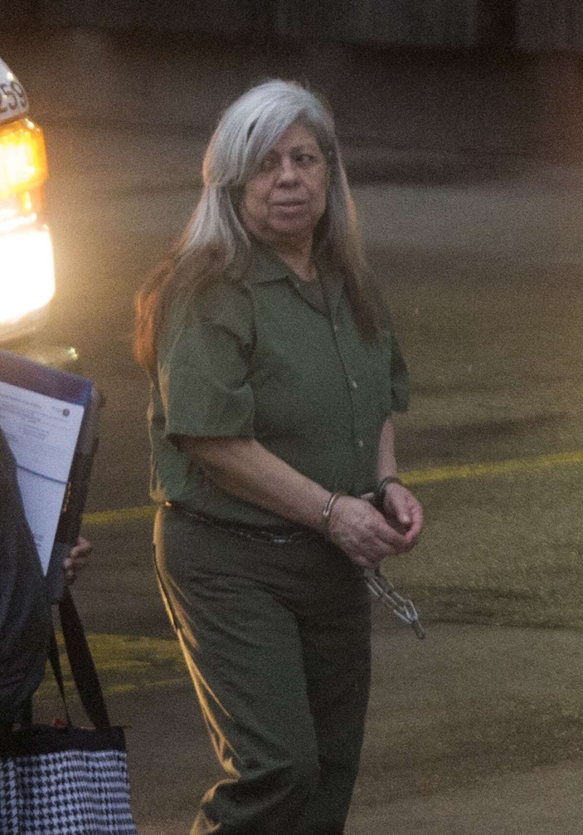 Hortencia Medeles enters the Federal Courthouse, Monday, April 13, 2015, in Houston. She was convicted of running a sex trafficking operation and faces up to life in prison. A woman has gone to federal court to demand that Medeles be ordered to pay her restitution for the months she worked for her as a prostitute, while 16 years old. (Cody Duty / Houston Chronicle)