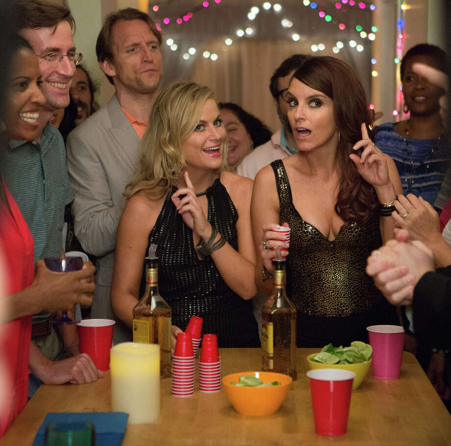"In this image released by Universal Pictures, Amy Poehler, left, and Tina Fey appear in a scene from the film, ""Sisters."" (K. C. Bailey/Universal Pictures via AP) Photo: K.C. Bailey /Associated Press / Universal Pictures"