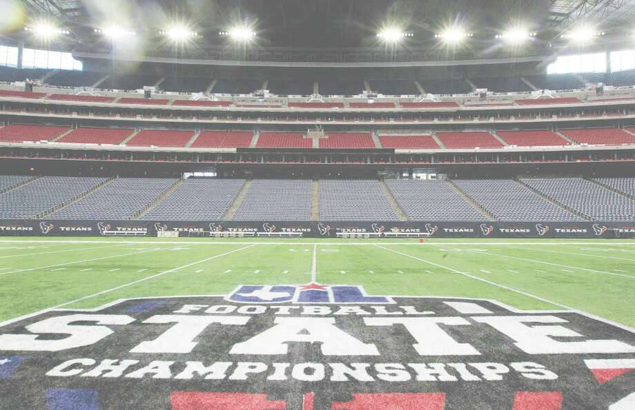 A UIL Football State Championship logo is shown on the field of at NRG Staduim Wednesday, Dec. 16, 2015, in Houston. The UIL Football State Championship games will be played December 17-19 at NRG Stadium. ( Melissa Phillip  / Houston Chronicle ) Photo: Melissa Phillip, Staff / Â 2015 Houston Chronicle