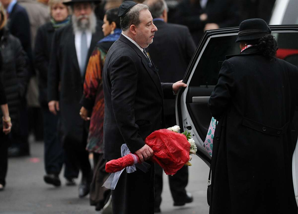 Lenny Pozner leaves the funeral service for his six year-old Noah Pozner, killed in the mass shooting at Sandy Hook Elementary School in Newtown, at the Abraham L. Green Funeral home in Fairfield on Monday, December 17, 2012.