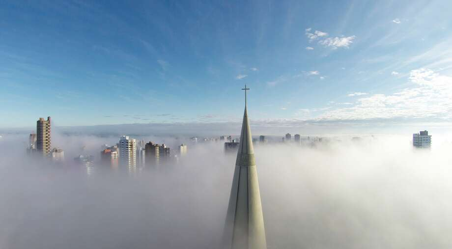 "Above the mist, Maringá, Paraná, Brazil. ""One day I saw a picture taken from an airplane, showing the center of a city surrounded by a heavy fog exposing only the tops of buildings. Since that day, I had the desire to take a picture like that; but only of my town."" — Ricardo Matiello. Photo: Ricardo Matiello, Dronestagram"
