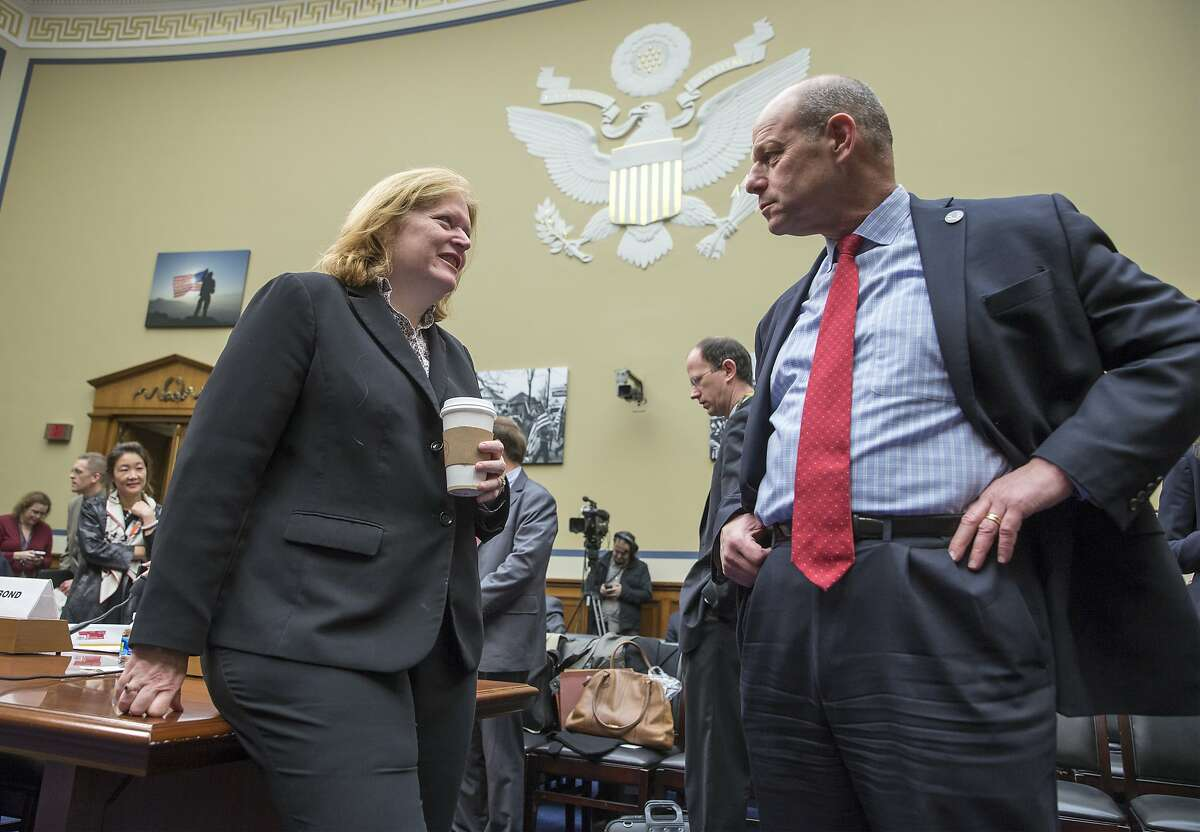 Anne Richard, assistant secretary of the Bureau of Population, Refugees, and Migration at the State Department, left, speaks with Leon Rodriguez, director of U.S. Citizenship and Immigration Services at the Homeland Security Department, on Capitol Hill in Washington, Thursday, Dec. 17, 2015, prior to their testifying before the House Oversight and Government Reform Committee hearing to answer concerns about the safeguards in place to ensure that would-be extremists are not exploiting a variety of legal paths to travel to the United States.